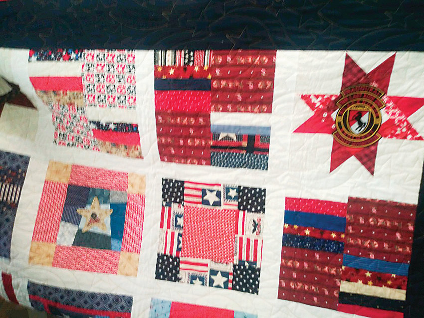 "The Quilt of Valor Foundation makes heirloom quilts that are given to service members and veterans for comfort and healing. Christian Redman received this one, which includes a Blackhorse ""Last Ride"" patch, designed to honor Redman's Last Ride and subsequent such events. The quilt ""becomes an heirloom once the veteran passes,"" as it is handed down to family members, Blackhorse veteran Rocky Cuda said."