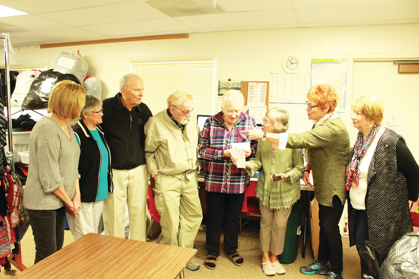 Kathy Nutting, Ruth Woytek, Dick Sargent, Russ Gleason, Karen Cravens, Nancy Hoffmaster, Diana Huffman and Donna Connolly gather for the check presentation.