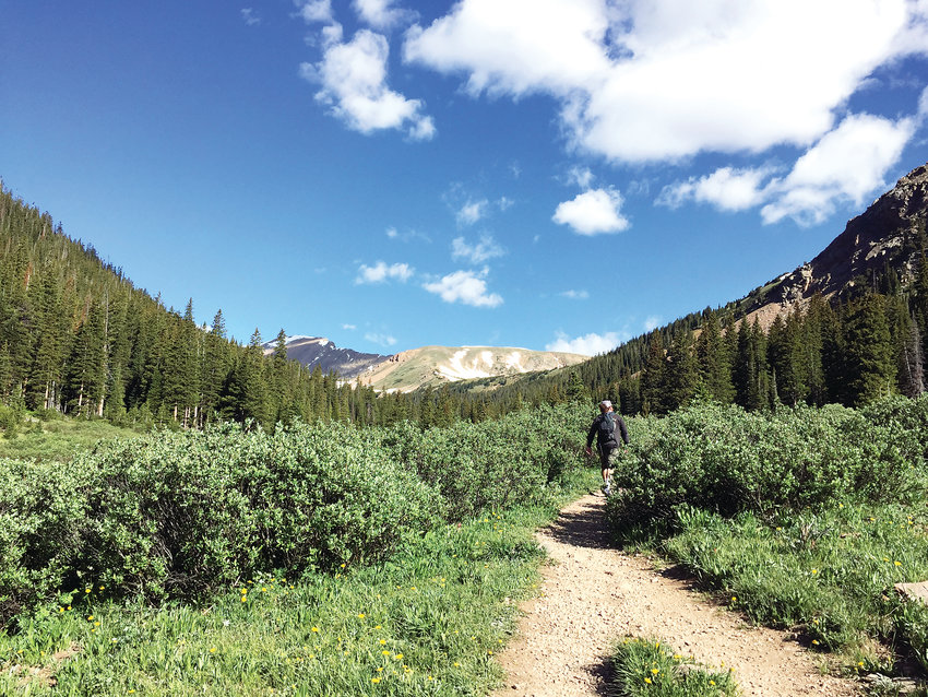 A hiker makes his way through Herman Gulch Trail near Dillon. One study found that 30 minutes of nature exposure per week reduces depression by 7 percent and can reduce high blood pressure by 9 percent.