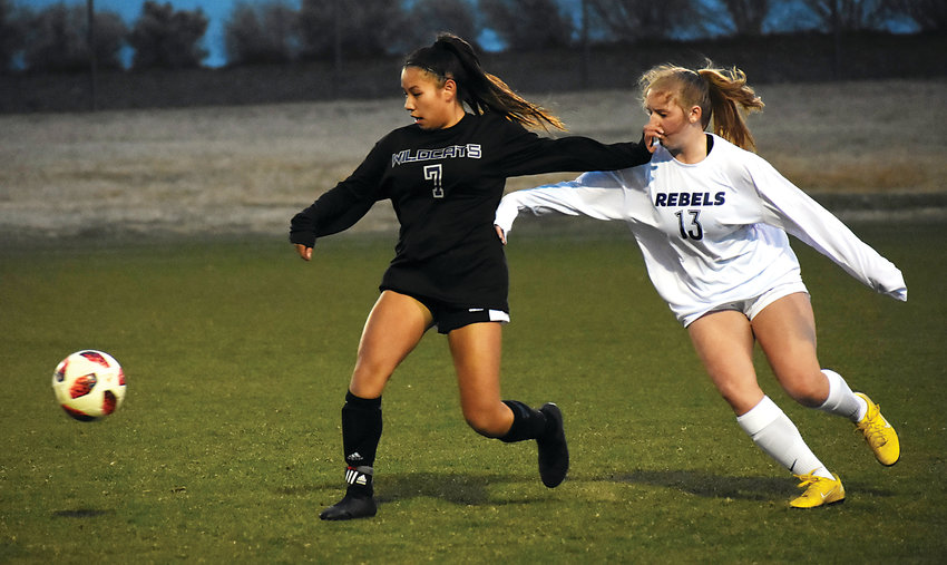 Arvada West junior Arianna Chinda (7) and Columbine junior Amanda Mohrlang (13) race after the ball during the opening half Wednesday, April 3, at the North Area Athletic Complex. The Wildcats suffered a 2-1 overtime loss in their Class 5A Jeffco League opener.