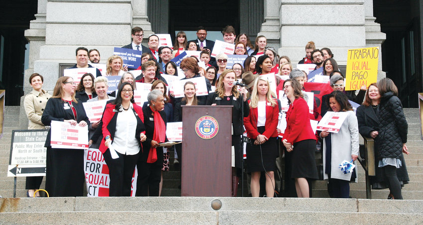 A crowd gathers on the steps of the Colorado State Capitol Building on April 2 to demonstrate their support of SB 19-085, the Equal Pay For Equal Work Act bill, which is currently working its way through the legislature.
