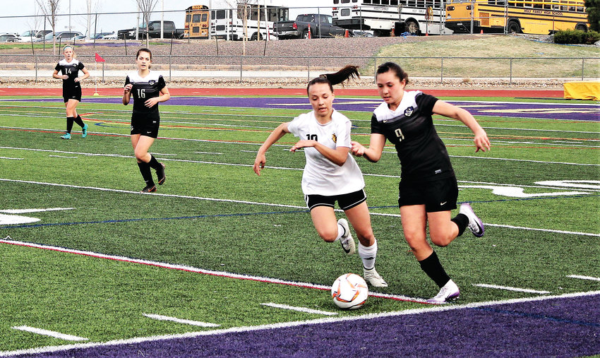 Lady Tigers' sophomore Jaelen Giron sprints down the sideline against Green Mountain April 5.
