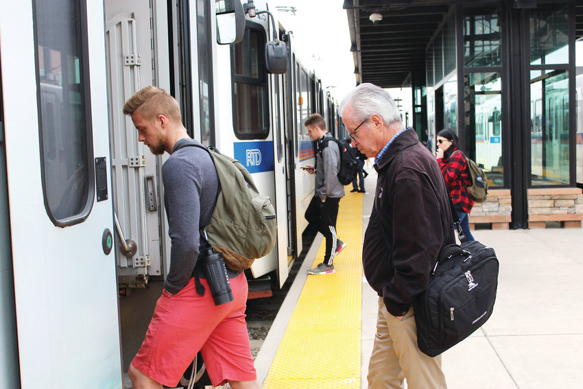 Passengers board the light rail F Line at the Lincoln Station April 16. About 6,000 people use the Lincoln Station on a given weekday, according to the Regional Transportation District. On May 19, the Southeast Rail Extension will open to the public.
