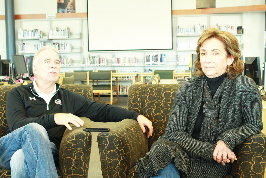 Bruce Beck, stepfather of Lauren Townsend, and Dawn Anna, her mother, speak to the media in the Columbine Hope Memorial Library recently. The Lauren Townsend Memorial Wildlife/Scholarship Fund was started in honor of Lauren Townsend.