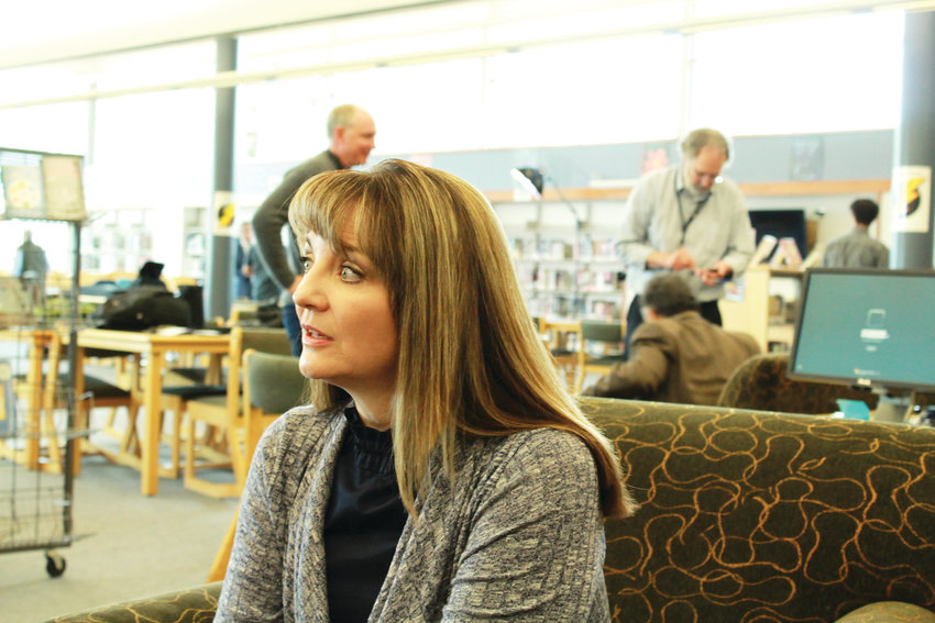 Coni Sanders is the daughter of Dave Sanders, a teacher who was killed during the Columbine shooting. Coni, shown here in the Columbine Hope Memorial Library, works with violent offenders and the mentally ill as a forensic therapist.