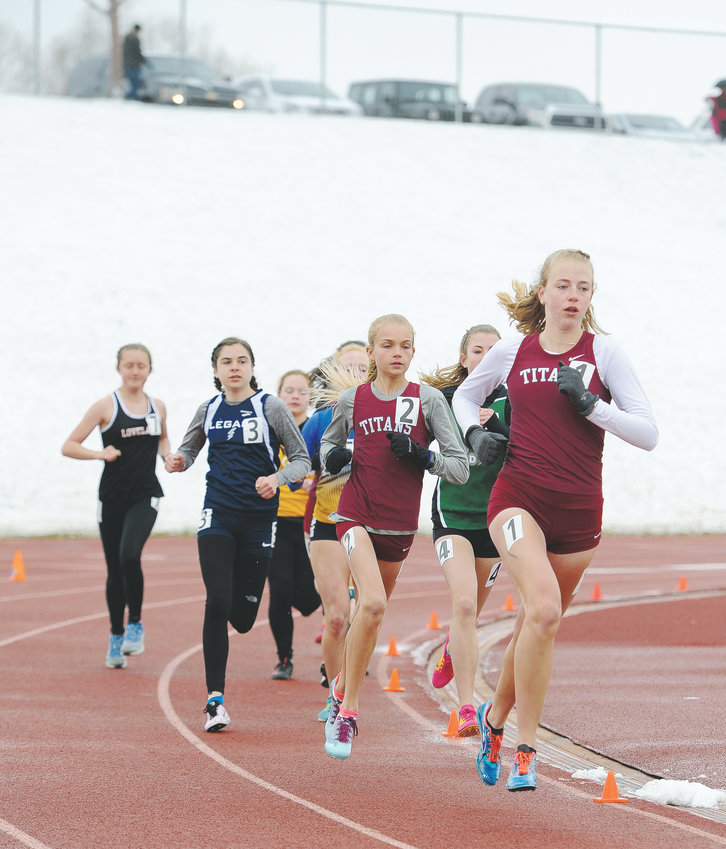 Classical Academy runners Katie Flaherty, right, and Kennedy McDonald, lead the pack, which includes Legacy's Brynn Siles, left, during the first lap of the Girls 3200 meter run April 13 Mountain Range Invite Track and Field Meet at District 12 North Stadium. Flaherty won the event with a time of 11:29.