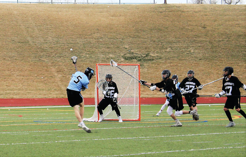 MR senior Jack Smith fires a shot April 12 at North Stadium against Prairie View.