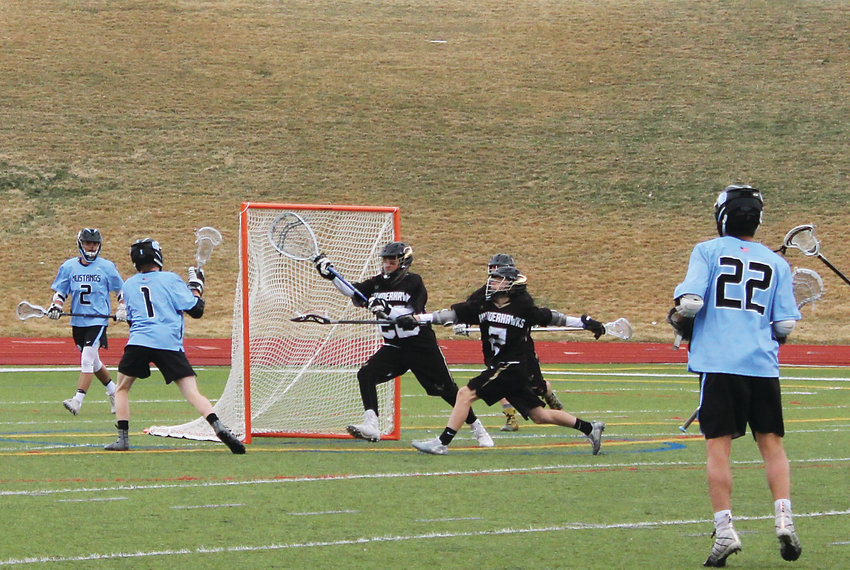 Mustangs' senior Ryan Reffel scores one of his team-leading five goals against Prairie View at North Stadium April 12.