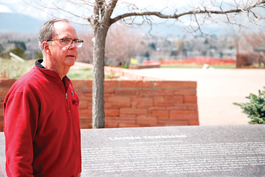 "Rick Townsend, the father of Columbine victim Lauren Townsend, visits the Columbine Memorial at Clement Park on April 12. Townsend, the president of the Columbine Memorial Foundation, said visiting the memorial feels like ""saying hi to Lauren."""