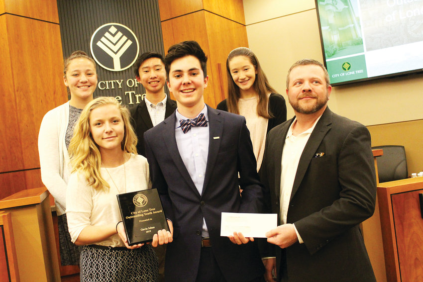 Gavin Johns poses with his Lone Tree Outstanding Youth of the Year award. From left Ava Taylor, Julia Reigrut, Marcus Tsuei, Johns, Anna Smith, Vincent Neal.