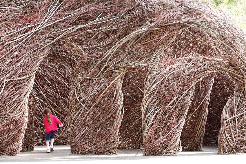"Patrick Dougherty will construct a new immersive sculptural work at Denver Botanic Gardens at Chatfield. Example shown is ""Ready or Not"" at the North Carolina Zoo (2013). The new piece will be introduced April 27."