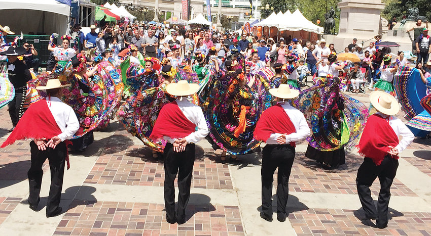 Performers attract a crowd at Denver's Cinco de Mayo Festival. This year's event takes place May 4 and 5 at Civic Center Park in downtown Denver.