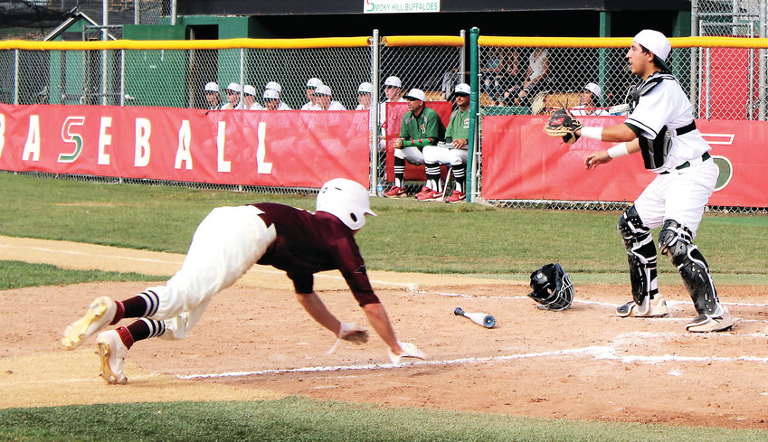 Horizon senior Brandon Aragon scores the Hawks' second run of the game April 15 against Smoky Hill.