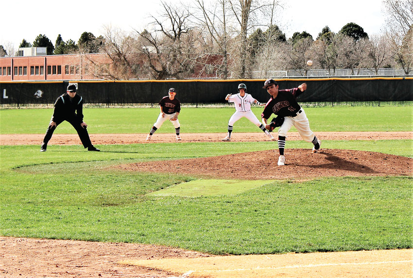 Horizon freshman Jacob Olguin-Pacheco delivers the pitch April 15 against Smoky Hill.