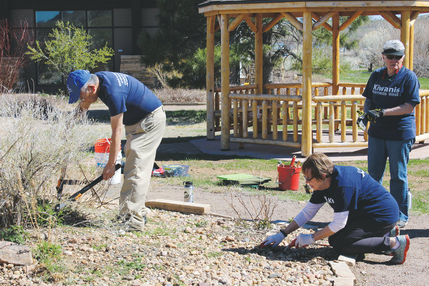 Following the presentation, members of the W. Alameda Kiwanis Club did volunteer work at Bear Creek Lake Park.