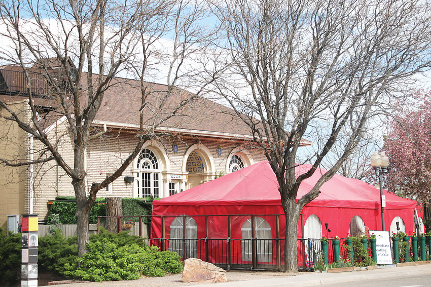 A pair of proposed shade structures would replace the red tents the Melting Pot currently uses to host outdoor diners in the winter.