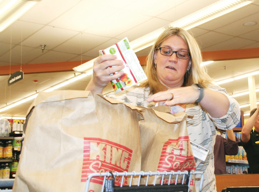 Katie Burder, an admin in the county manager's office, races to bag groceries the fastest during the 2019 Bag-Off on April 24 at the Golden King Soopers. The Bag-Off is the kickoff event for the Jeffco Employee Food & Cash Drive, which takes place May 1-17.