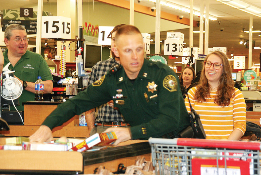 Jeffco Sheriff's Captain Scott Happ competes in the 2019 Bag-Off competition, which took place on April 24 at the Golden King Soopers. The sheriff's office won this year's Bag-Off, which is the kickoff event for the Jeffco Employee Food & Cash Drive, which takes place May 1-17.