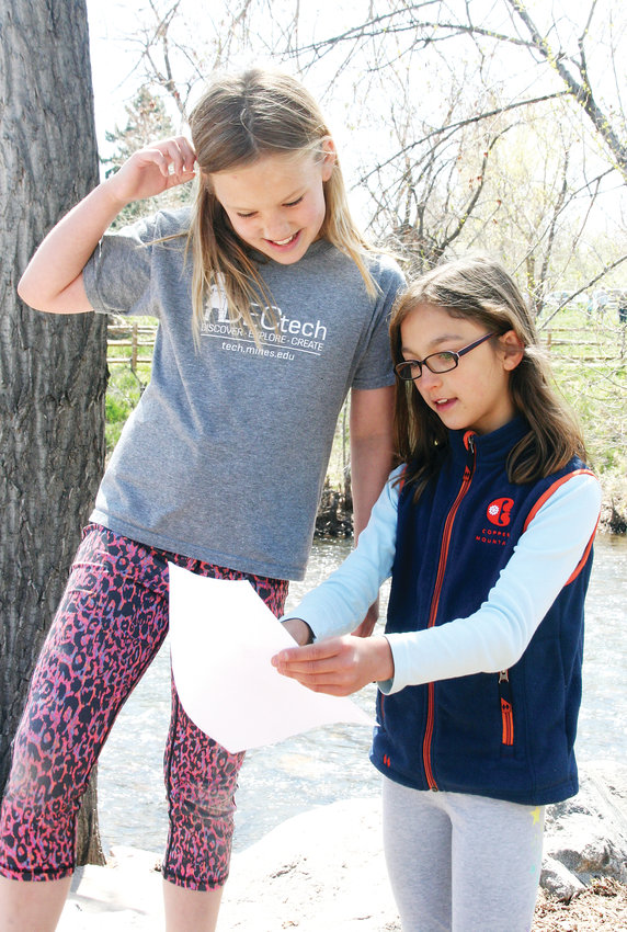 Hannah Holsing, left, and Jada Call, both fourth graders at Mitchell Elementary School, work together on the ideas they have to improve Clear Creek, which will be used by Colorado School of Mines students for a class project.