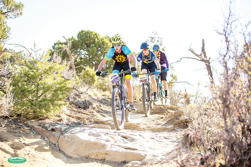 Members of the Colorado High School Cycling League race through a trail in Durango.