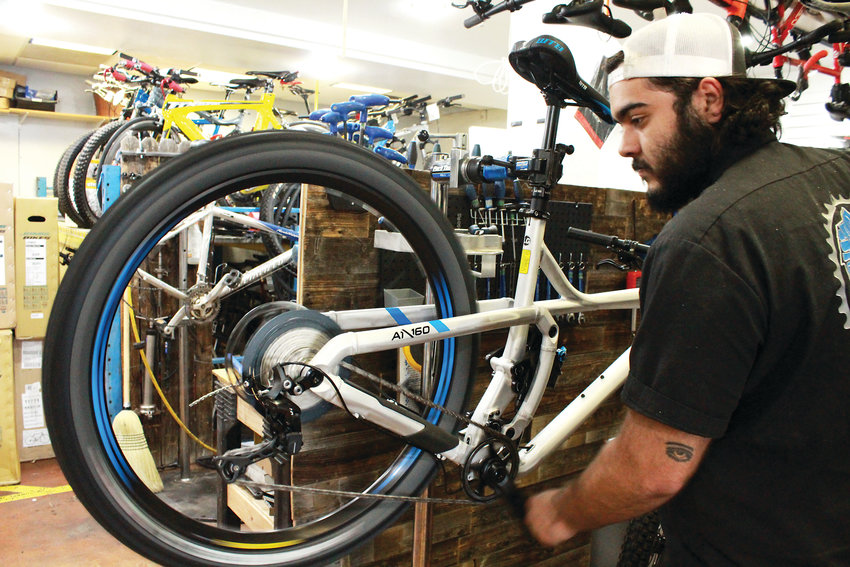 Paul Rodriguez, owner of the Bicycle Shack in Arvada, works on a bike.