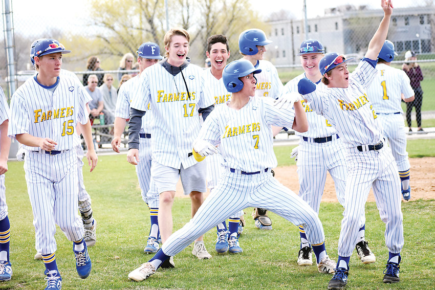 Wheat Ridge players celebrate after junior Dominic Bronk (7) hit a two-run home run in the sixth inning Tuesday, April 23, at Chuck Griffith Jr. Field. The Farmers used a five-run sixth inning to take a 6-1 victory over Evergreen.