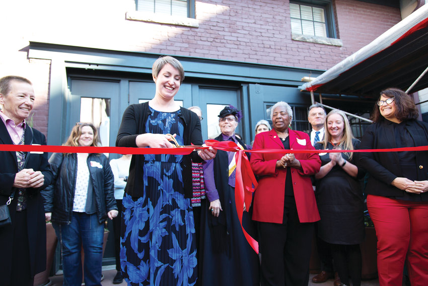 Jillian Allison, director of Center for Colorado Women's History, cuts the ribbon at the opening on March 21, 2018. At the end of March, the Center opened a new exhibit, Women/Work/Justice.