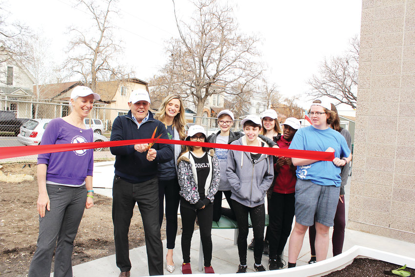 Carol Bowers, left, joins several students as well as Larry Mueller from PIVOT, second from left, to cut the ribbon to the new gardening space at the Girls Athletic Leadership Schools (GALS). Mueller is the treasurer of PIVOT, a nonprofit focused on childhood education which donated the funds to GALS.