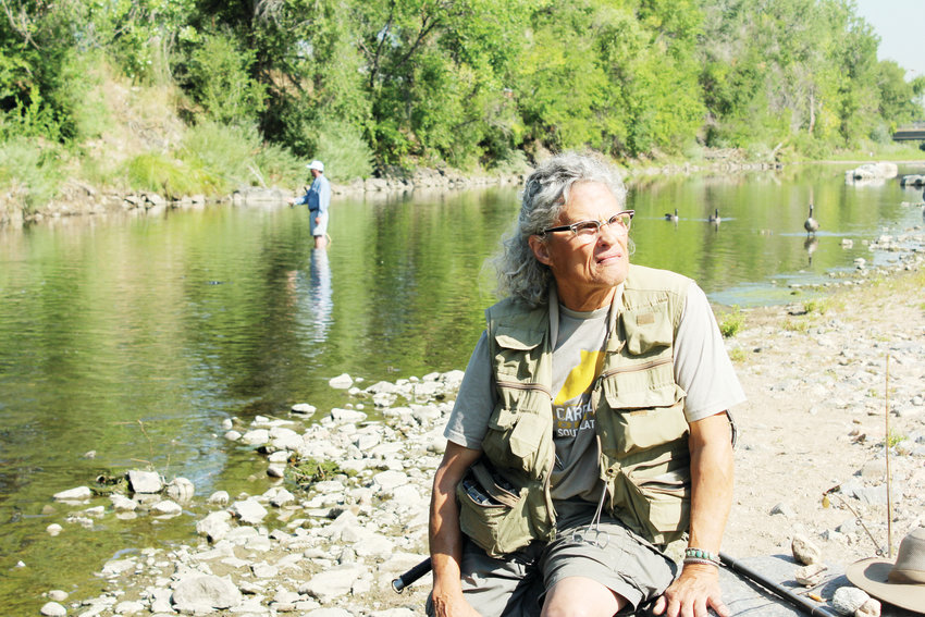 In this August 2018 photo, Ronnie Crawford sits on a rock at Grant Frontier Park in Overland. He and his friend Jesse Walsh spent the morning fishing in the South Platte River.