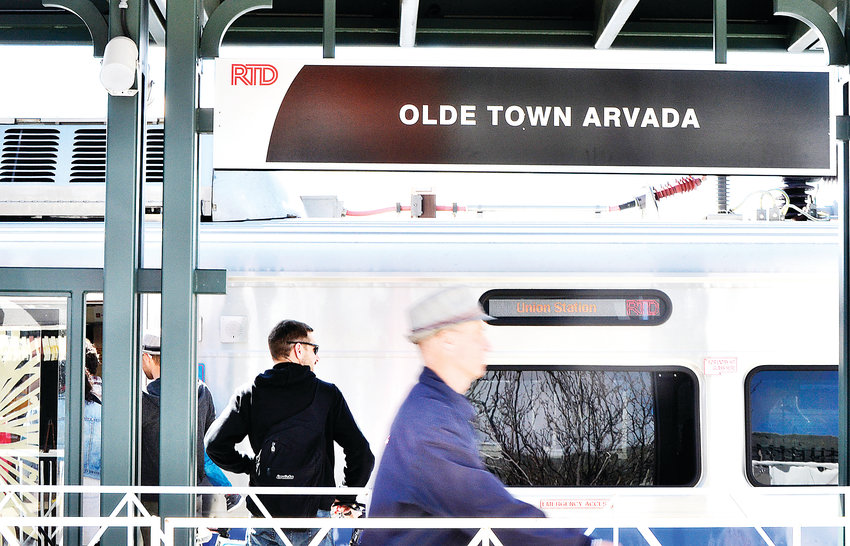 People board the G-Line during the grand opening celebration Saturday, April 27, in Olde Town Arvada.