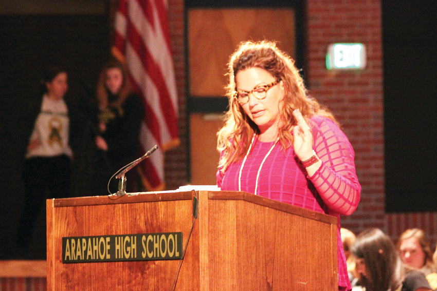 Jessica Roe, parent of an Arapahoe High School student, speaks on behalf of the Arapahoe High School Community Coalition at a special meeting on May 2. Roe's group alleges Arapahoe's leadership has mishandled the response to problems at the school.