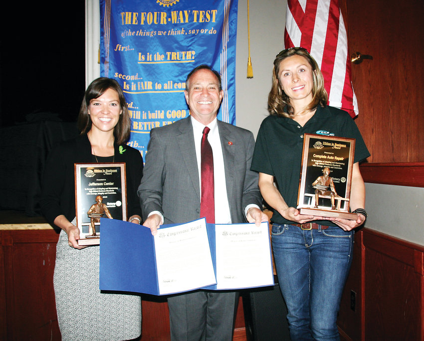 Congressman Ed Perlmutter, center, stands with Kiara Kuenzler, CEO of the Jefferson Center for Mental Health, left, and Shaunda Hosier, manager of Complete Auto Repair at the Rotary Club of Golden's Ethics in Business Awards Luncheon on May 3. Kuenzler and Hosier are holding their awards, and Perlmutter is holding the documentation that will enter the organizations into the congressional record.