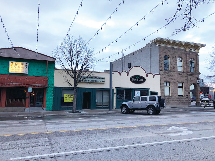 The owners of the building at center hope to have a historic landmark designation removed so they can redesign the front exterior of the structure. The plan is to open a craft cocktail lounge in the space.