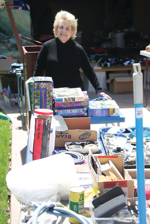 Julie Quisenberry stands ready to make deals at her annual yard sale along the Crabapple Route.