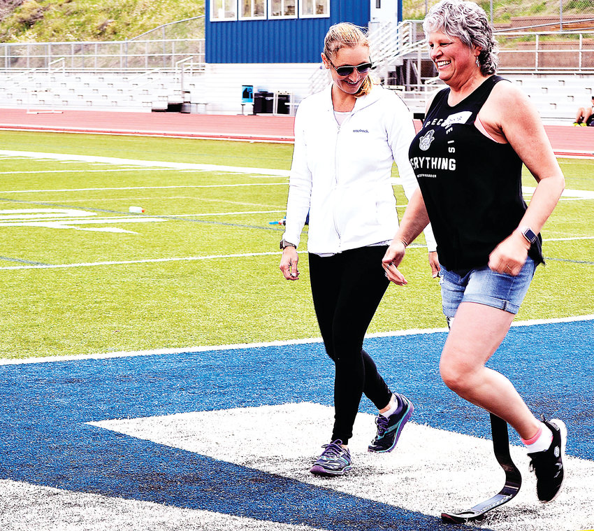Donna Thornburg of Westminster practices running with a prosthetic during the seventh annual Colorado Adaptive Mobility Clinic in Golden on Sunday, May 5. The running blade prosthetic is more conducive for running, which is Thornburg's goal after her leg was amputated two years ago.