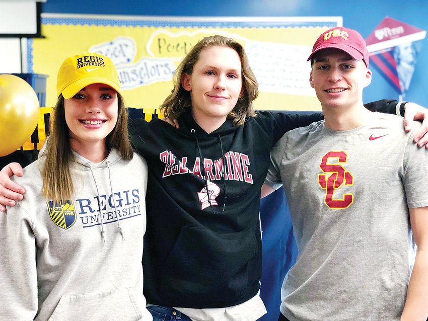 Wheat Ridge High School student athletes pose after announcing their college letter of intent signing event.