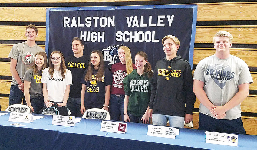 Ralston Valley student athletes pose at their National Letter of Intent signing day event.