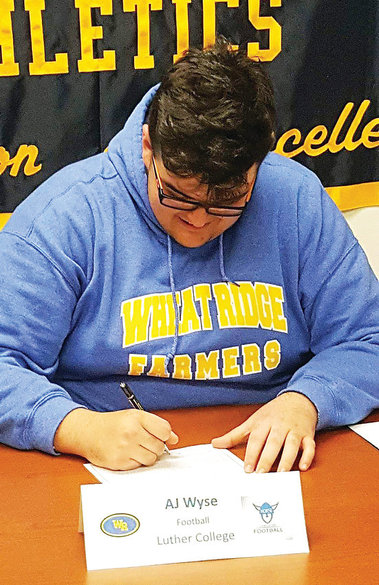 Wheat Ridge football standout AJ Wyse signs his letter of intent to play for Luther College next year.