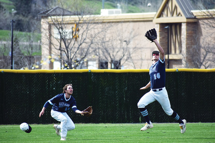 Ralston Valley senior AJ Jergensen (16) makes a running catch as left fielder Eliot Sterns loses his hat during the Mustangs' 8-2 victory May 2 against Dakota Ridge. Ralston Valley held a one-game lead in the Class 5A Jeffco League standings heading into the conference finales Tuesday, May 7.