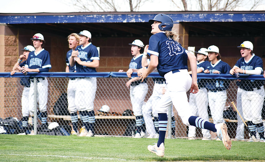 Ralston Valley senior Calvin Hunt (15) eyes his first of two home runs as the Mustangs' dugout reacts during the Mustangs' big Class 5A Jeffco League victory over Dakota Ridge on May 2. Hunt also picked up the victory on the mound going six strong innings.