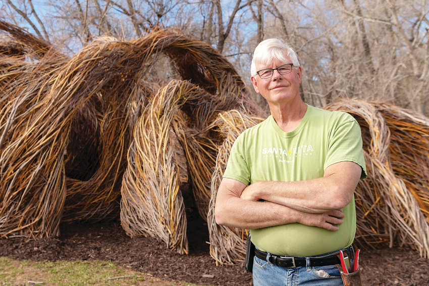 "Artist Patrick Dougherty with the newly finished ""One Fell Swoop"" at Denver Botanic Gardens at Chatfield Farms."