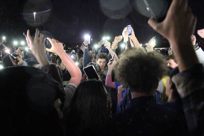 Students, including some from STEM School Highlands Ranch, hold up lit-up phones outside Highlands Ranch High School after walking out of a May 8 vigil amid frustration over STEM students getting speaking time. A shooting May 7 at STEM School wounded eight students and killed one, 18-year-old Kendrick Ray Castillo.