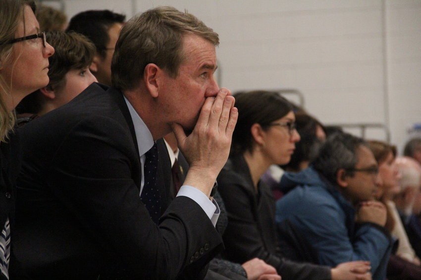 U.S. Sen. Michael Bennet, a Democrat of Colorado, sits after speaking at a May 8 vigil at Highlands Ranch High School for STEM School shooting victims and survivors.