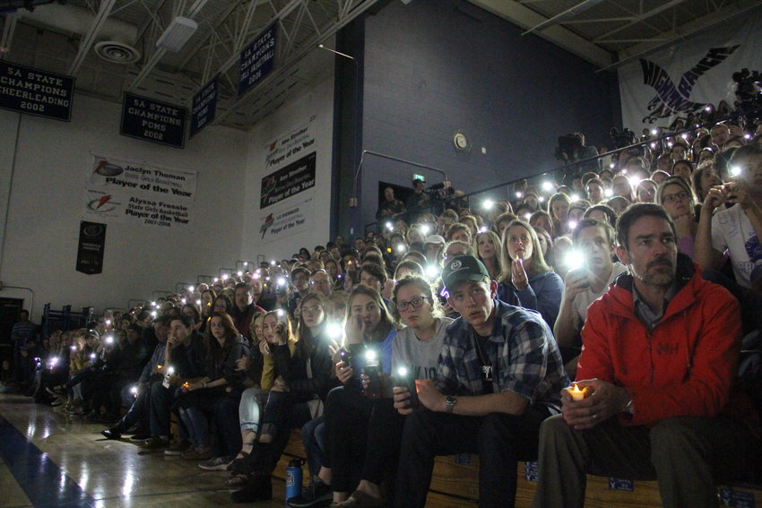 Hundreds of local students and parents light up their phones at a May 8 vigil at Highlands Ranch High School for STEM School shooting victims and survivors.