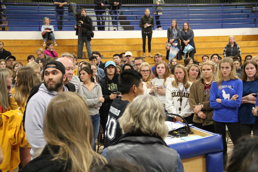 A student speaks during an impromptu succession of students, including STEM School students, who addressed the smaller crowd back in the gym after a large portion of it walked out into the hallway and outside Highlands Ranch High School. The May 8 vigil was in honor of STEM School shooting victims and survivors.