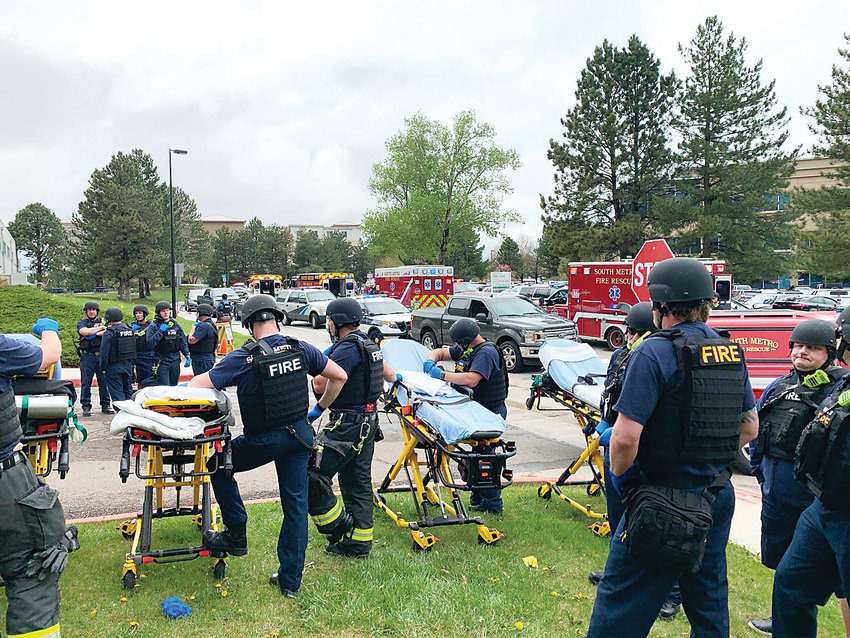 South Metro Fire Rescue personnel line up, ready to pull injured victims from STEM School Highlands Ranch on May 7. Personnel from numerous local agencies responded to the scene of the shooting.