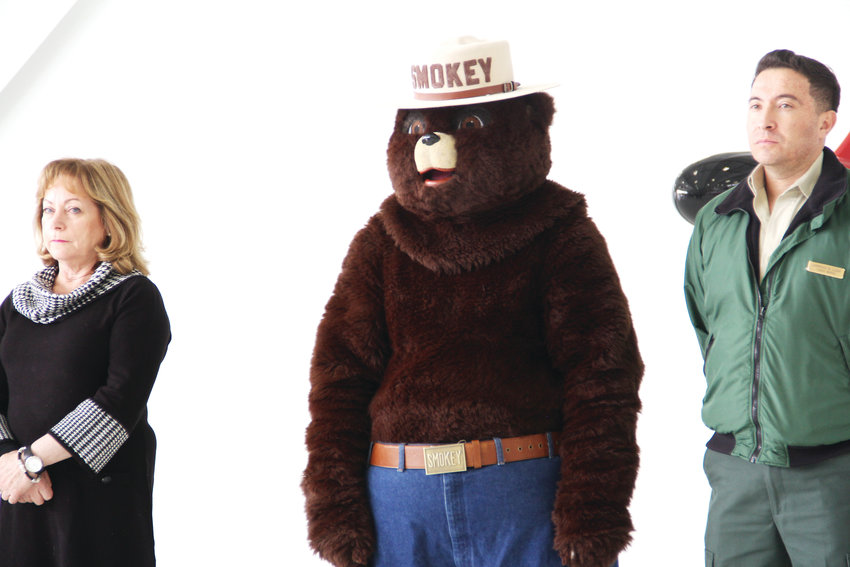 Smokey Bear, the federal government's mascot for wildfire prevention, stands next to Lt. Gov. Dianne Primavera, left, and other officials May 7 at the state's 2019 wildfire outlook event.