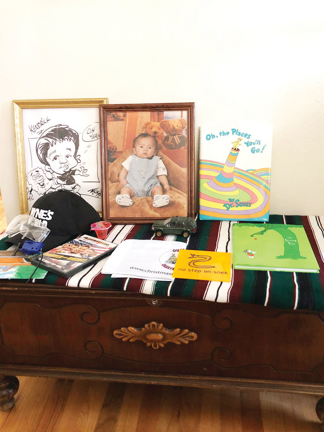 On Mother's Day, friends of Kendrick Castillo add to a makeshift shrine in his parent's dining room. Castillo was killed in a shooting at STEM High School on May 7.