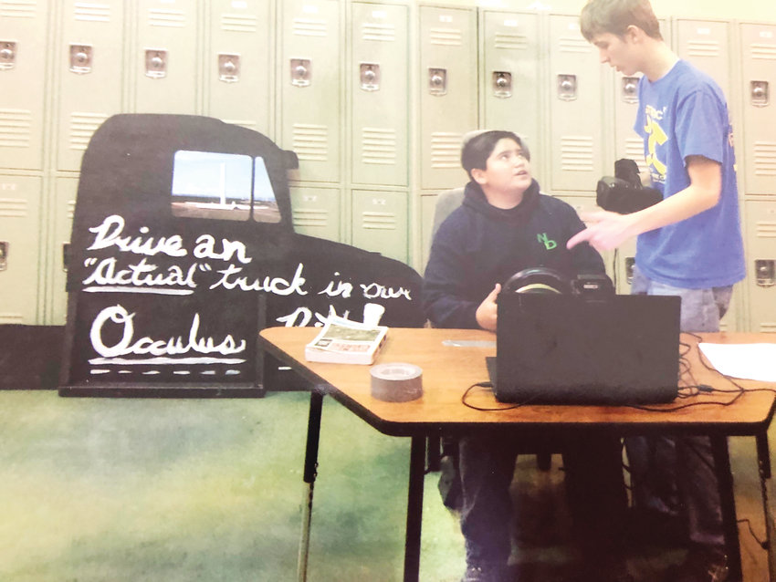 Kendrick Castillo helps a classmate at STEM High School in Highlands Ranch. Castillo was killed in a school shooting on May 7.