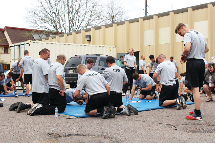 Recruits take a break during the pushup challenge.